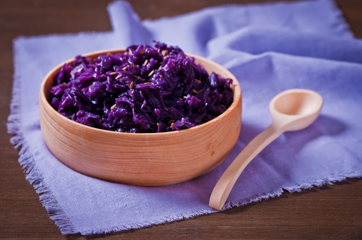 Red cabbage stewed  on the wooden bowl