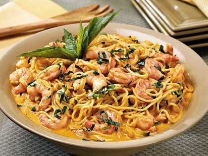 Shrimp with Roasted Red Pepper Cream Sauce over pasta